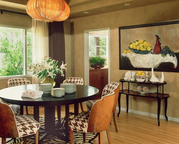 Modern dining room decorating with a wooden round table and upholstered  chairs. Feng Shui Home  Step 5  Dining Room Decorating