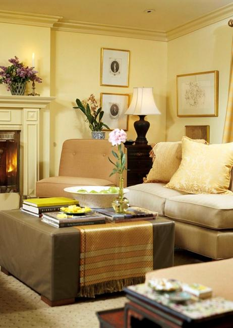 living room design with light yellow walls and furniture in neutral colors