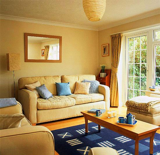 Soft Creamy Yellow Paint Rich Blue Carpet And Pillows For Living Room Decorating
