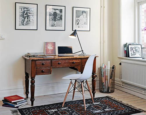 home office design in a corner of a room with wooden writing desk and chair