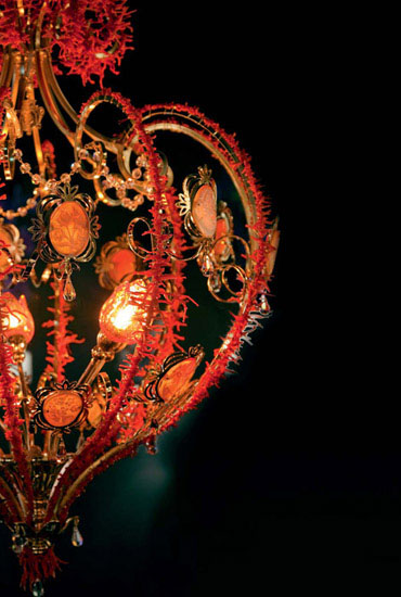 modern chandelier decorated with reef corals in red colors
