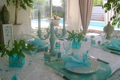 summer party table setting in white and turquoise colors