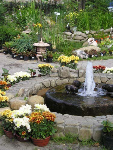 Garden Fountains Are Beautiful Water Features For Creating Attractive Backyard Designs