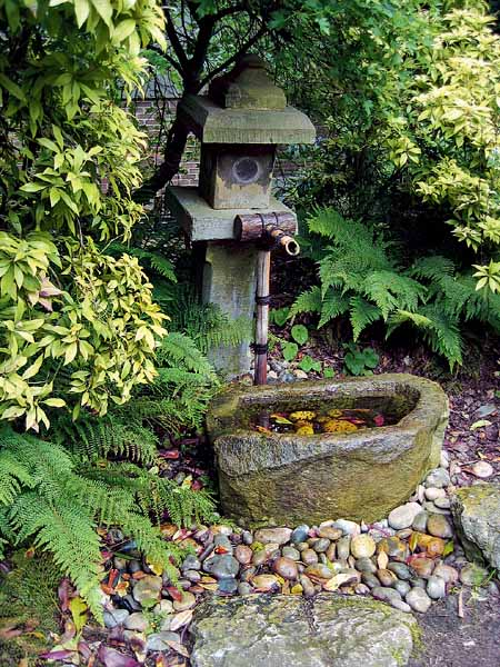 tsukubai water fountain is one of outdoor fountains for japanese garden design