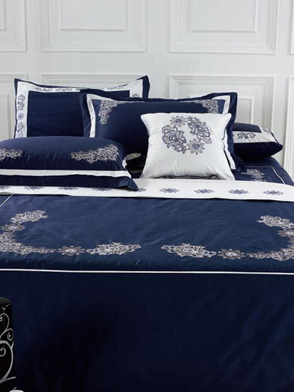navy blue bedding set with white trim and floral designs