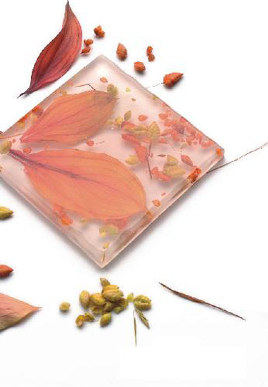 pink glass tile design with leaves