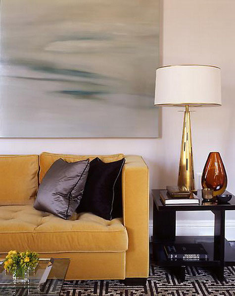 golden yellow finish of table lamp and golden yellow sofa upholstery fabric