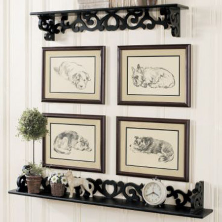 black and white wall decor with black shelves and picture frames