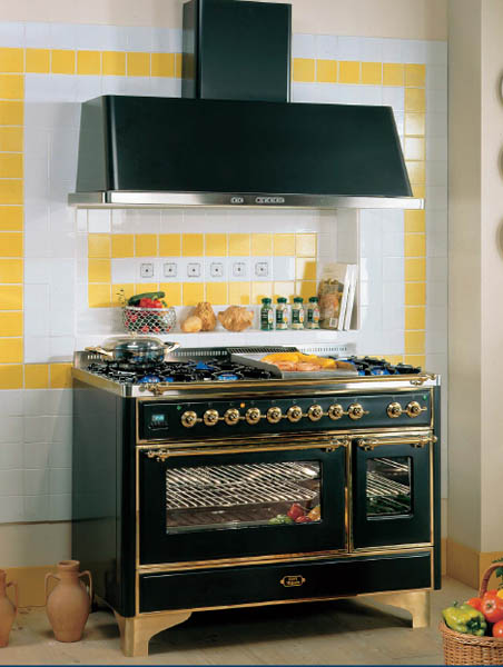 black retro kitchen stove and yellow wall tiles