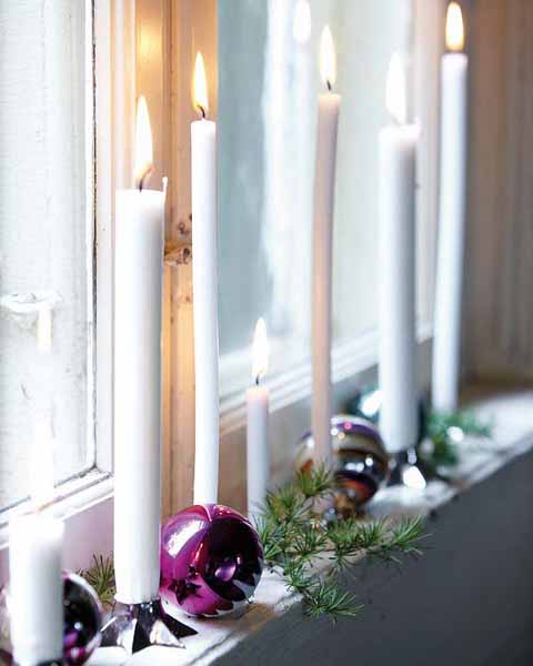 cascading to the window sill look gorgeous also evergreen and small indoor plants combined with glowing candles nestles among the foliage - Window Sill Christmas Decorations