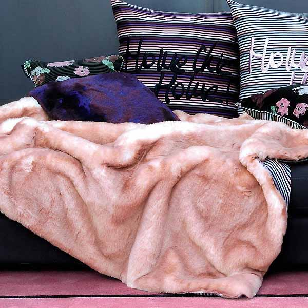 faux fur blanket in soft pink color