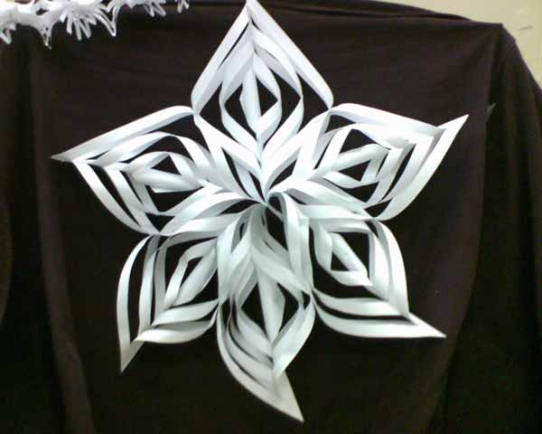 recycling paper and making snowflakes winter craft ideas for kids and adults - Christmas Decoration Ideas For Kids