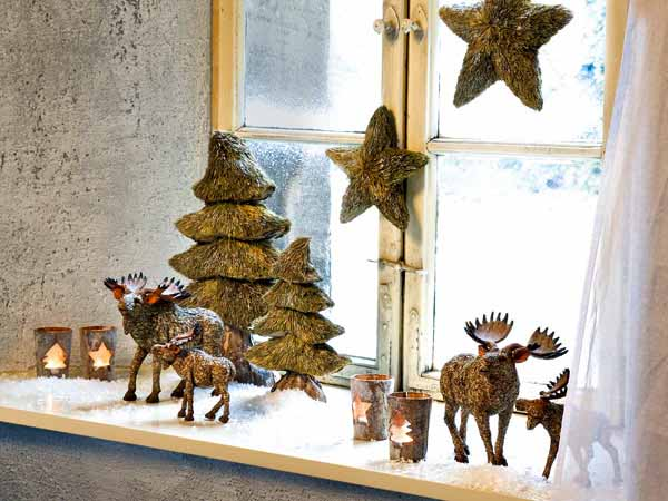 miniature christmas trees stars and animal figurines winter holiday decorations for window sill