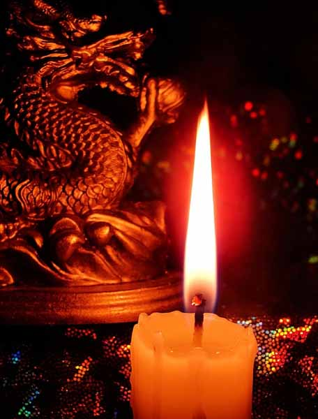 dragon figurine and candle