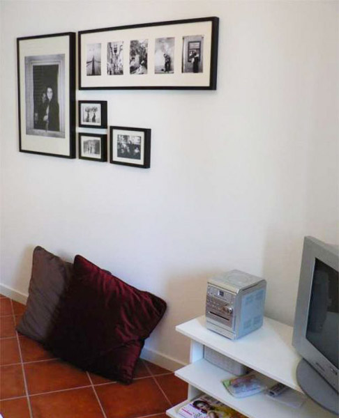 wall decorating with photos in black frames