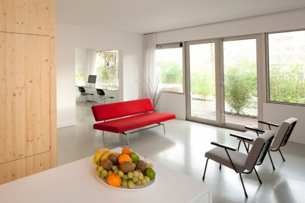 living room design with red sofa and gray chairs