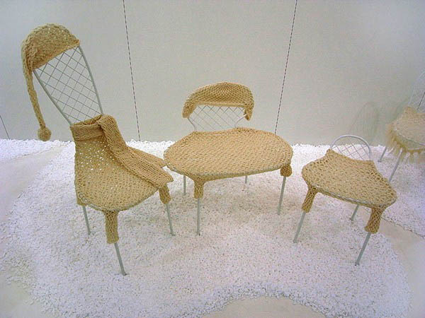 modern chairs in knitted clothes and accessories