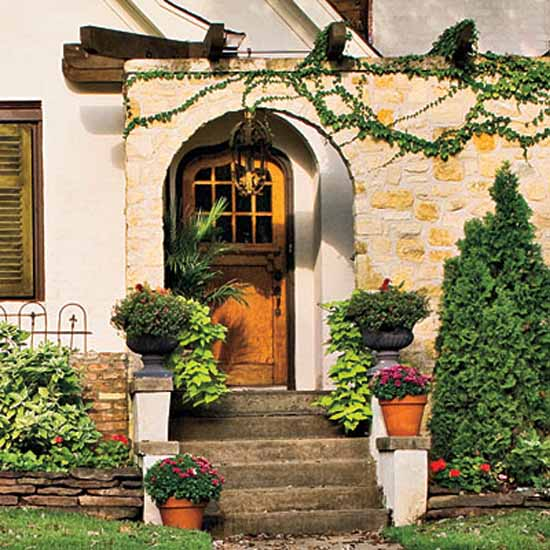 Traditional House Exterior With A Wooden Door Simple Entrance Design And Decorating Flowers