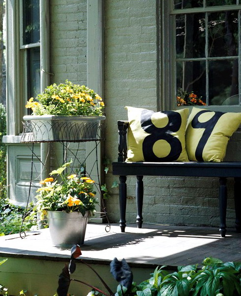Entryway Bench With Pillows And Attractive Containers Blooming Plants For House Entrance Decorating