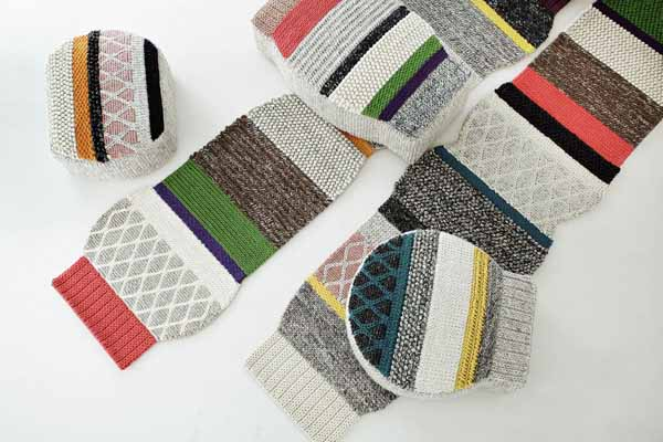 contemporary rugs and knitted poufs