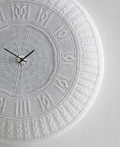 white wall clock with knitted cover