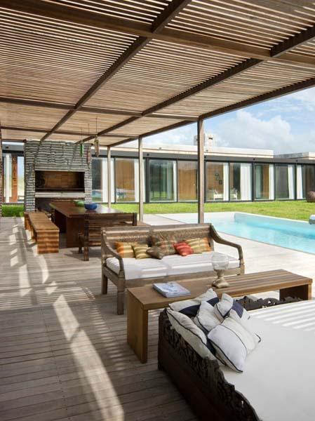 outdoor rooms with wooden ceiling and pool