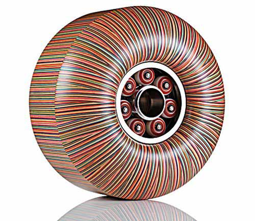 colorful wheel sculpture made of old skateboards