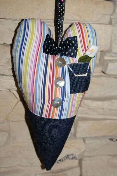 heart decoration made of striped fabric with blue bow
