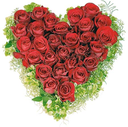heart shaped floral arrangement with red roses