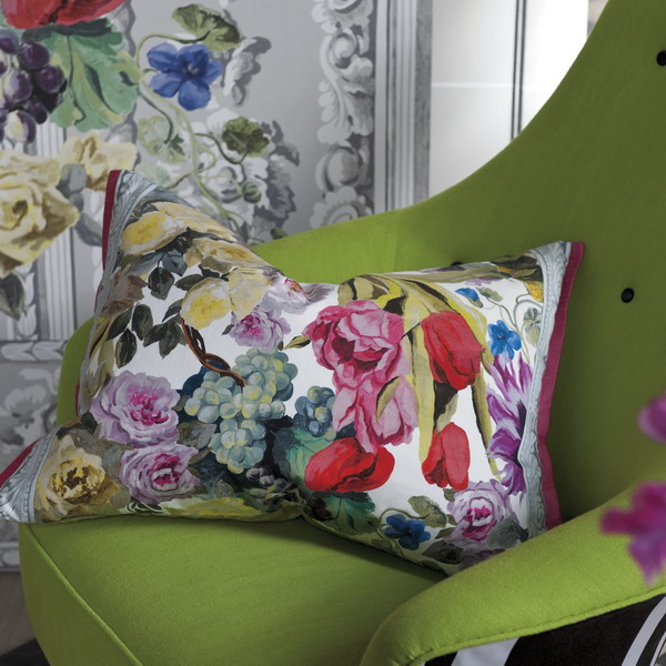 bright floral pillow for green chair