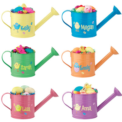 watering cans with easter eggs and toys