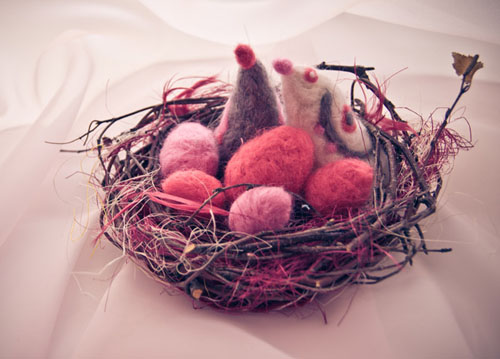 handmade nest with pink eggs and bird for easter decorating