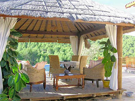 thatched roofing and patio furniture