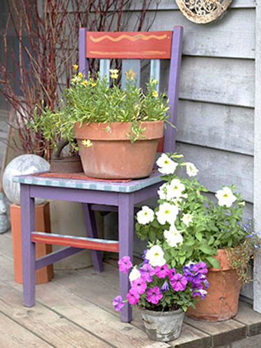 wood chair with flowers for backyard decoraitng