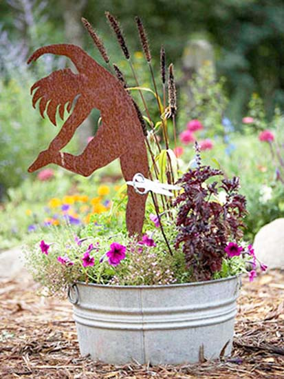 dancer and flowers in metal bucket