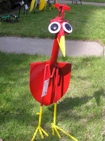 red bird made of old garden tools