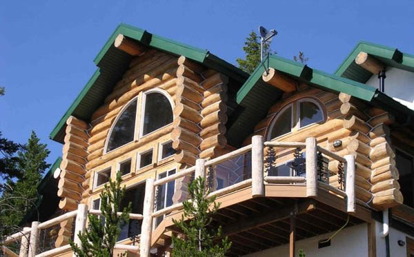 log home with balcony