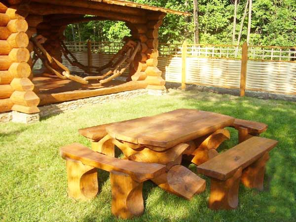 gazebo and table with chairs made of logs