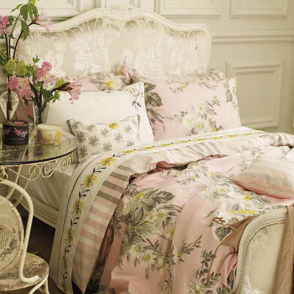 pink bedding set with white flowers