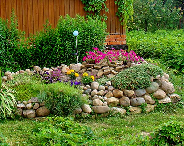 Rocks Garden Design With Blooming Plants Should Be Arranged Away From Large  Trees, Which Create Shade And Take Water And Nutrients From The Soil, ...