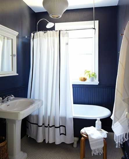 White Bathroom Decor In The Room With Blue Walls And Bathtub