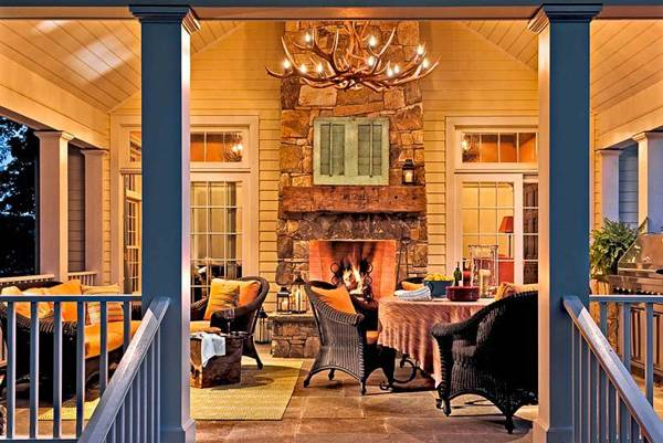 porch decorating with outdoor fireplace and dining furniture