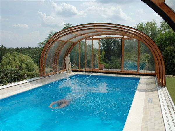 Indoor swimming pools and pool enclosures add luxury to for Inground indoor pool designs