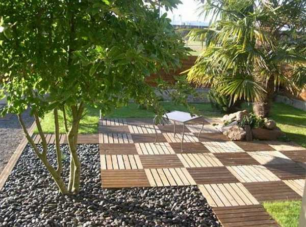 composite deck tiles in light and dark brown colors