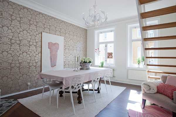 antique dining table and modern wallpaper with floral pattern
