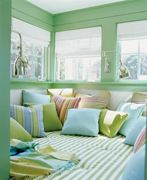 Green Paint And Colorful Pillows In Pastel Colors
