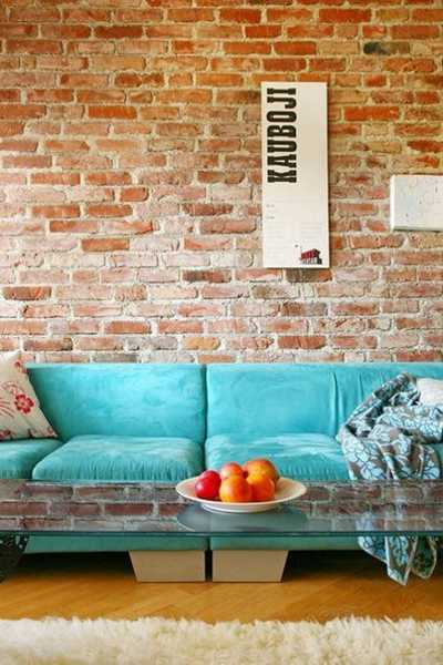 blue sofa and brick wall