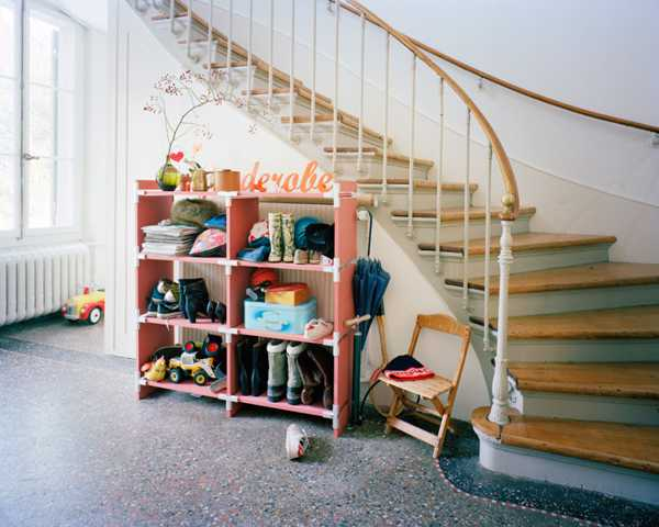 shelving unit under staircase