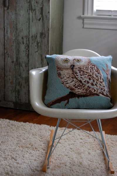 pillow with owl on pine twig