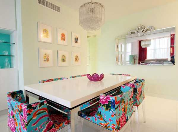 white dining table and colorful chairs